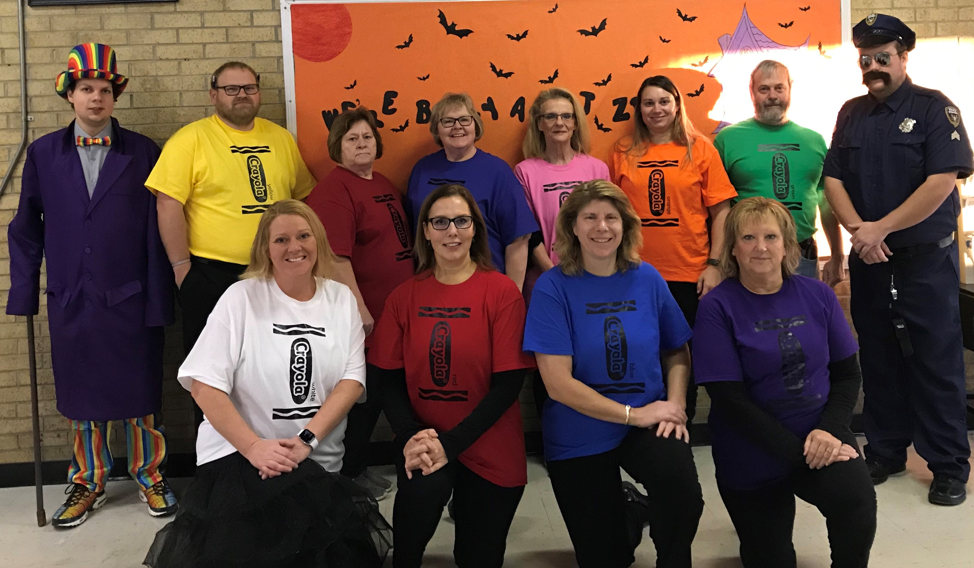 Image of school faculty and staff dressed for Halloween
